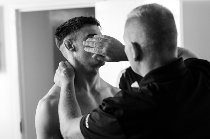 """Luke Paddock being prepared by the """"best cuts man in the business""""."""