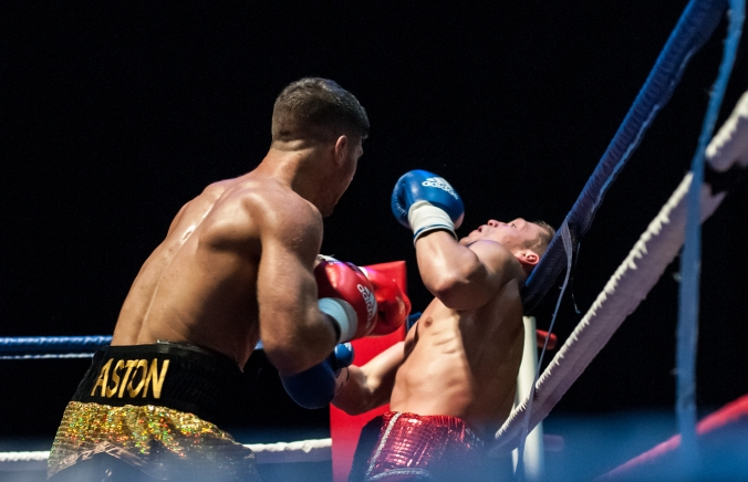 """Ryan """"Tank"""" Aston has his opponent on the ropes."""